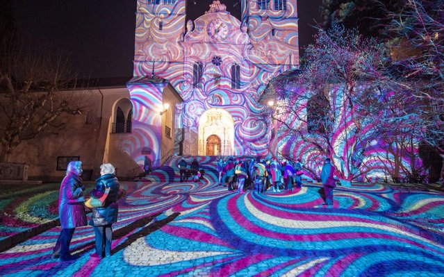 """The light projection """"En-Trance"""" by Projektil is on show at the Church of St. Leodegar during the pre-opening of the Lilu Light Festival in Lucerne, Switzerland, 08 January 2020. The festival runs from 09 to 19 January. (Photo by Urs Flueeler/EPA/EFE/Rex Features/Shutterstock)"""