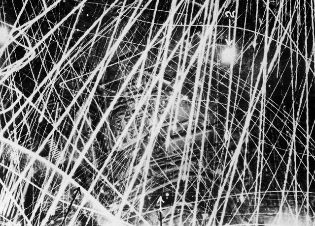 This photograph was taken on Jan. 31, 1941, during a nigthtime air raid carried out by the Royal Air Force above Brest, France. It gives a graphic impression of what flak and anti-aircraft fire looks like from the air. In the period of three to four seconds during which the shutter remained open, the camera clearly captured the furious gunfire. The fine lines of light show the paths of tracer shells, and the broader lines are those of heavier guns. Factories and other buildings can be seen below