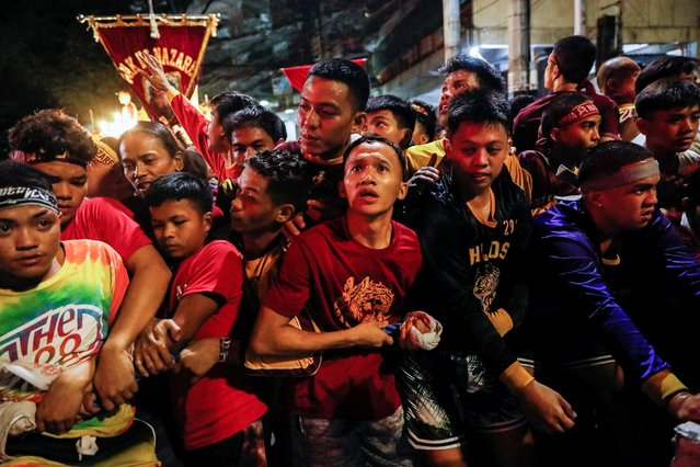 Filipino devotees attempt to get through cops surrounding the route of the Black Nazarene procession during its feast day in Manila, Philippines, January 9, 2020. (Photo by Eloisa Lopez/Reuters)