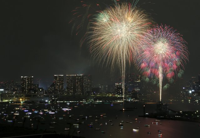 Fireworks explode over small ships on the Tokyo's Odaiba bay during the Tokyo bay fireworks festival in Tokyo, Japan, August 8, 2015. (Photo by Yuya Shino/Reuters)