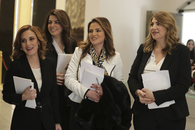 The women ministers in the new Lebanese government, from left to right; Minister of Youth and Sports Vartie Ohanian, Minister of Displaced Ghada Shreim, Minister of Information Manal Abdul-Samad and Justice minister Marie-Claude Najem posing for photographs after the first cabinet meeting, at the presidential palace, in Baabda, east of Beirut, Lebanon, in Beirut, Lebanon, Wednesday, January 22, 2020. A new Cabinet has been announced last night in crisis-hit Lebanon, breaking a months-long impasse amid mass protests against the country's ruling elite. (Photo by Hassan Ammar/AP Photo)