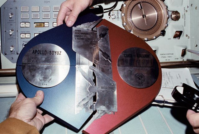 The Apollo-Soyuz Test Project (ASTP) Commemorative Plaque is assembled in the Soviet Soyuz Orbital Module during the joint U.S.-USSR Apollo-Soyuz Test Project docking mission in Earth orbit. The plaque is written both in English and Russian. 17-18 July 1975. (Photo by NASA)
