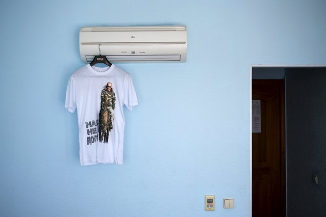 """A t-shirt with a picture of Russian President Vladimir Putin and the text """"They can't catch us"""" is seen in this photo illustration taken in a hotel room in Kazan, Russia, July 30, 2015. (Photo by Stefan Wermuth/Reuters)"""