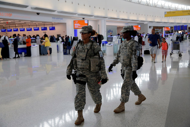 Members of the U.S. Army monitor the departures area at John F. Kennedy international Airport in the Queens borough of New York, U.S., June 29, 2016. (Photo by Andrew Kelly/Reuters)