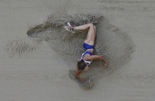 Britain's Jessica Ennis-Hill lies in the sand as she competes in the women's long jump heptathlon at the World Athletics Championships at the Bird's Nest stadium in Beijing, Sunday, August 23, 2015. (Photo by Wong Maye-E/AP Photo)