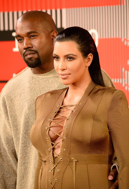Recording artist Kanye West (L) and tv personality Kim Kardashian attend the 2015 MTV Video Music Awards at Microsoft Theater on August 30, 2015 in Los Angeles, California.  (Photo by Frazer Harrison/Getty Images)