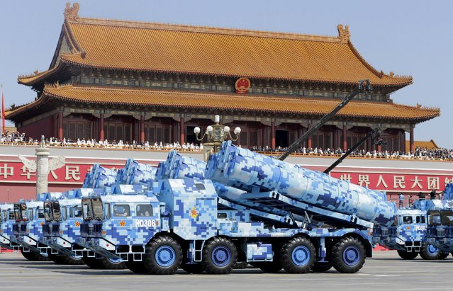 Military vehicles carrying shore-to-ship missiles drive past the Tiananmen Gate during a military parade to mark the 70th anniversary of the end of World War Two, in Beijing, China, September 3, 2015. (Photo by Jason Lee/Reuters)