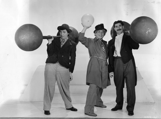 """Leonard """"Chico"""" (1887–1961), Adolph """"Harpo"""" (1888–1964) and Julius """"Groucho"""" (1895–1977) Marx in a publicity still from the film """"At The Circus"""" (aka """"The Marx Brothers at the Circus"""") directed by Edward Buzzell and produced by MGM, 1939. (Photo by Hulton Archive)"""
