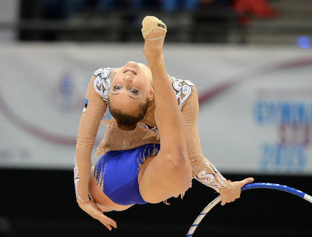 Olga Bogdanova of Estonia in action during the individual hoop qualifier at the World Rhythmic Gymnastics Championships at the Porsche Arena in Stuttgart, Germany, 07 September 2015. (Photo by Bernd Weissbrod/EPA)