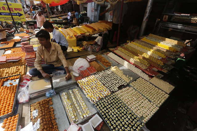 An Indian vendor displays sweets for sale on Diwali, the festival of lights, in Allahabad, India, Thursday, October 19, 2017. (Photo by Rajesh Kumar Singh/AP Photo)