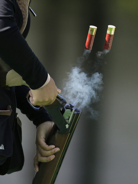 South Korea's Lee Bo-na ejects empty cartridges during the women's double trap shooting competition at the 17th Asian Games at Gyeonggido Shooting Range in Incheon, South Korea, Thursday, September 25, 2014. (Photo by Dita Alangkara/AP Photo)