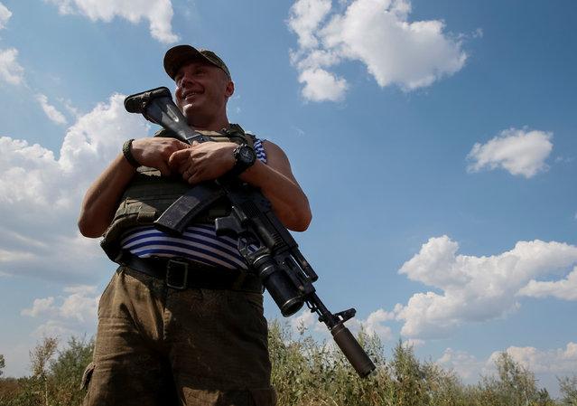 A Ukrainian serviceman is seen at his position on the front line in Krasnogorivka near Donetsk, Ukraine, August 12, 2016. (Photo by Gleb Garanich/Reuters)