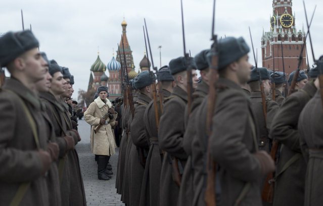 Russian soldiers dressed in Red Army World War II uniforms prepare for the historical parade in Red Square in Moscow, Russia, on Tuesday, November 7, 2017. The parade marked the 76th anniversary of a World War II historic parade in Red Square and honored the participants in the Nov. 7, 1941 parade who headed directly to the front lines to defend Moscow from the Nazi forces. (Photo by Ivan Sekretarev/AP Photo)