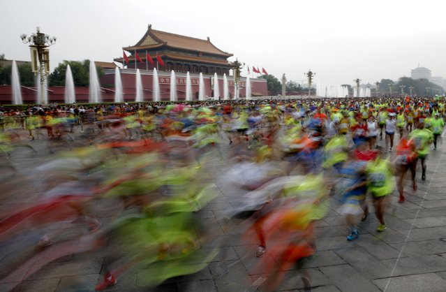 Participants run past the Tiananmen gate during the Beijing International Marathon in Beijing, China, September 20, 2015. (Photo by Kim Kyung-Hoon/Reuters)