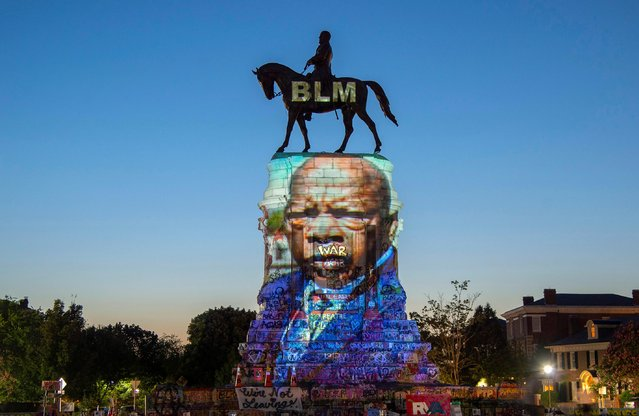 The image of late Rep. John Lewis, a pioneer of the civil rights movement and long-time member of the U.S. House of Representatives, is projected on the statue of Confederate General Robert E. Lee in Richmond, Virginia, U.S. July 19, 2020. (Photo by Jay Paul/Reuters)