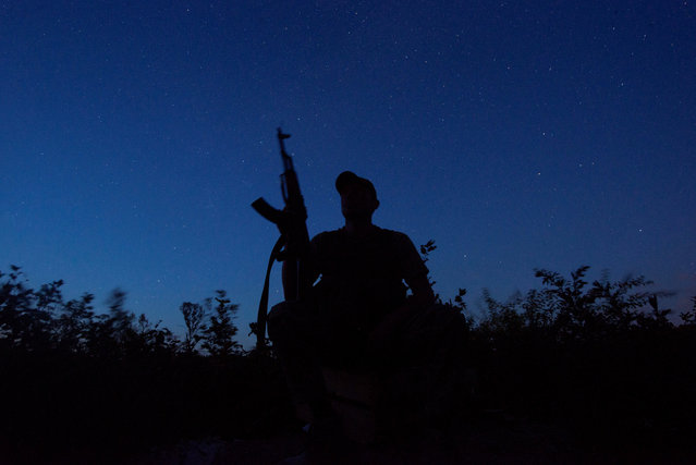 A Ukrainian serviceman is seen at a position on the front line near the town of Novotoshkivske in Luhansk region, Ukraine on July 26, 2020. (Photo by Iryna Rybakova/Press Service of Ukrainian Defence Ministry/Handout via Reuters)