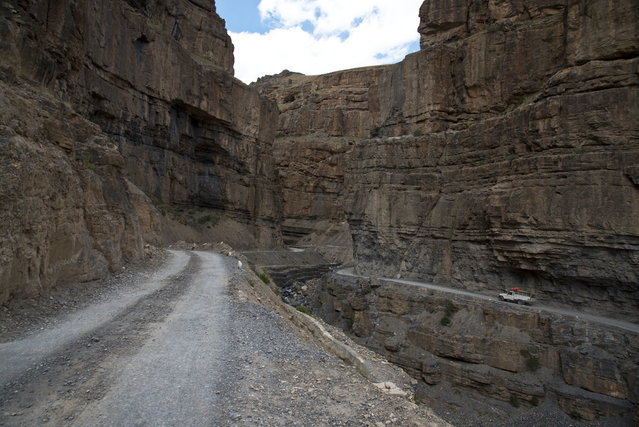In this August 15, 2016, photo, a car drives along a mountain road that leads to Spiti Valley, a remote Himalayan valley situated at 4000 meter above sea level, India. It takes about ten hours to reach from Manali, a city in Himachal Pradesh. (Photo by Thomas Cytrynowicz/AP Photo)