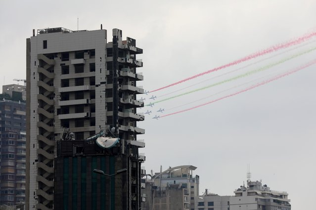 Aircrafts fly past damaged buildings and release smoke in the colours of the Lebanese flag as French President Emmanuel Macron visits Lebanon, in Beirut, Lebanon on September 1, 2020. (Photo by Mohamed Azakir/Reuters)