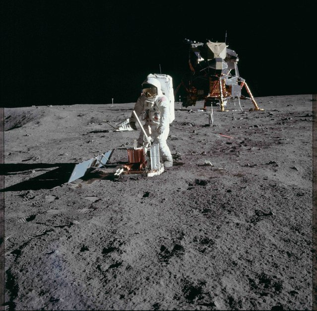"Astronaut Edwin E. Aldrin Jr., lunar module pilot, deploys a scientific research package on the surface of the moon near the Lunar Module (LM) ""Eagle"" during the Apollo 11 extravehicular activity (EVA) in this July 20, 1969 NASA handout photo. (Photo by Reuters/NASA)"