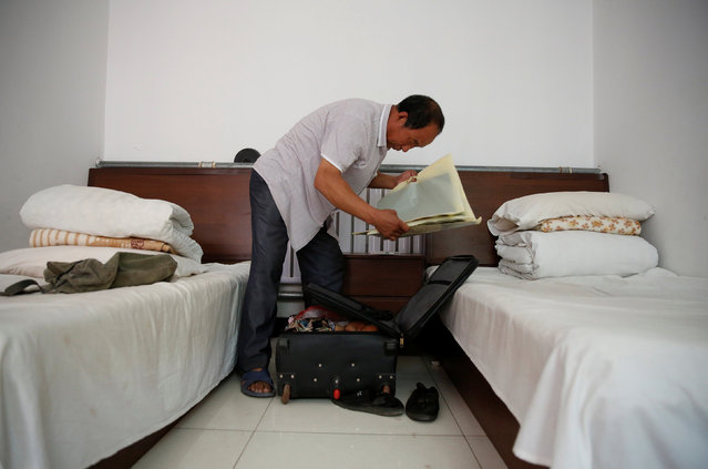 Pan packs his suitcase as he prepares to check out of the accommodation where some patients and their family members stay while seeking medical treatments in Beijing, China, June 23, 2016. Pan's wife Huang,  suffers from rectal cancer, and the couple came from Inner Mongolia to seek treatment at a specialist hospital in Beijing. (Photo by Kim Kyung-Hoon/Reuters)