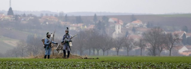Historical re-enactment enthusiasts dressed as soldiers stand guard near the southern Moravian village of Herspice November 28, 2014. (Photo by David W. Cerny/Reuters)