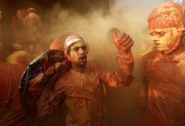 Hindu devotees take part in the religious festival of Holi inside a temple in Nandgaon village, in the state of Uttar Pradesh, India February 25, 2018. (Photo by Adnan Abidi/Reuters)