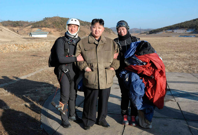 The leader of North Korea, Kim Jong Un, poses with members of the Western Area Aviation Club after watching a demonstration by them in an undisclosed location in this undated picture released on January 28, 2012. (Photo by Reuters/KCNA)