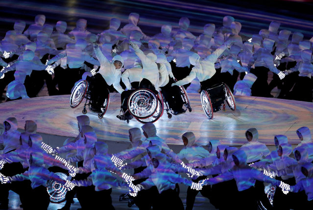 Artists perform during the opening ceremony for the XII Paralympic Winter Games in the PyeongChang Olympic Stadium, PyeongChang, South Korea, Friday, March, 9, 2018. (Photo by Paul Hanna/Reuters)