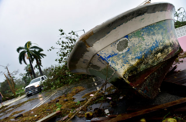 A boat lies on Eastern Road near Fort Montague in the aftermath of Hurricane Matthew striking Nassau, Bahamas October 6, 2016. (Photo by Dante Carrer/Reuters)