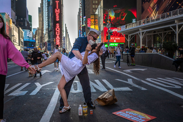 Times Square was one of many NYC locations where thousands filled the crossroads of the world to celebrate the Biden/Harris election win over Donald Trump on Saturday,  November 7, 2020. This couple was thrilled with the news reenacting the famous sailor nurse WW2 victory in Times Square kiss. (Photo by Michael Nigro/Pacific Press/Rex Features/Shutterstock)