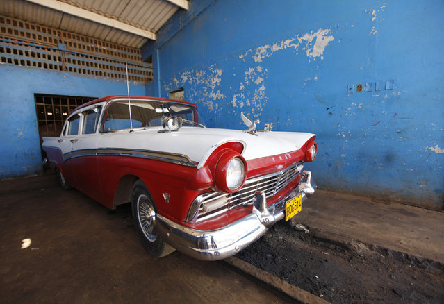 A Ford Motor Company 1954 V8 model car parked in a garage in the village of Quivican, south of Havana, October 11, 2009. (Photo by Desmond Boylan/Reuters)