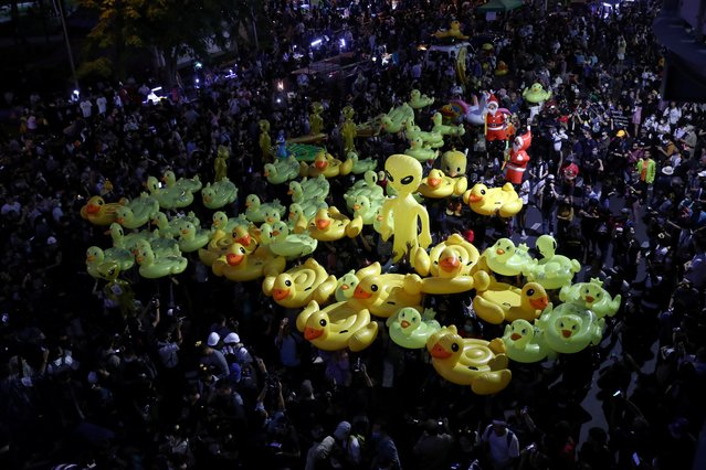 Protesters hold inflatable toys during a pro-democracy rally demanding the prime minister resign and reforms on the monarchy, in Bangkok, Thailand, November 27, 2020. (Photo by Athit Perawongmetha/Reuters)