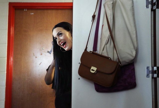 Singer Katy Perry peeks her head around a dorm room door while canvassing for Democratic presidential nominee Hillary Clinton in a dorm at UNLV, Saturday, October 22, 2016, in Las Vegas. After some squealing and selfies with the students, she urged them to cast their ballots for Clinton. (Photo by John Locher/AP Photo)
