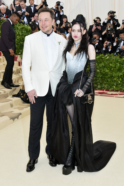 Elon Musk and Grimes attend the Heavenly Bodies: Fashion & The Catholic Imagination Costume Institute Gala at The Metropolitan Museum of Art on May 7, 2018 in New York City. (Photo by Neilson Barnard/Getty Images)