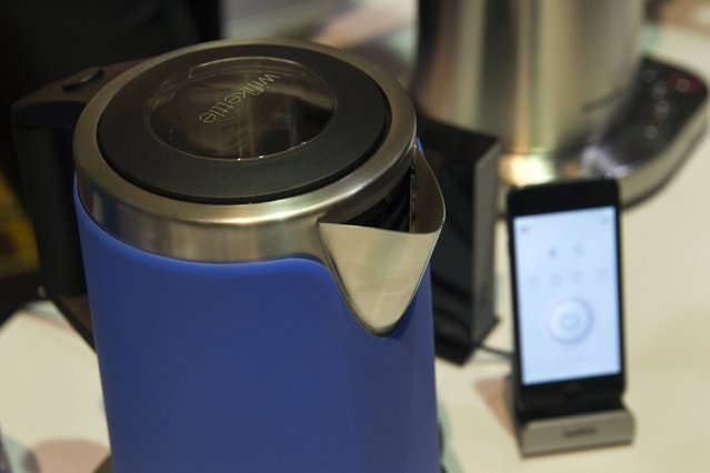 Internet-enable kettles and coffee makers by Smarter are displayed during the 2015 International Consumer Electronics Show (CES) in Las Vegas, Nevada January 4, 2015. The kettle and coffee maker can be controlled by a smart phone. The coffee maker will also alert the owner if it is running low on coffee or lacking water in the device. (Photo by Steve Marcus/Reuters)