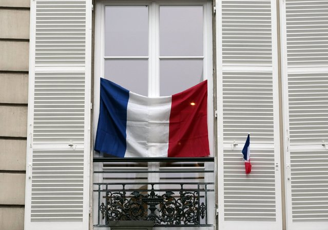 French flags hang from a windows of an apartment building in Paris, France, November 27, 2015. The French President called on all French citizens to hang the tricolour national flag from their windows on Friday to pay tribute to the victims of the Paris attacks during a national day of homage. (Photo by Eric Gaillard/Reuters)