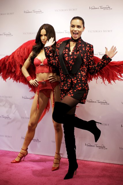 Victoria's Secret model Adriana Lima poses with her Madame Tussaud's wax likeness at a reveal event at the Victoria's Secret store in Herald Square in the Manhattan borough of New York November 30, 2015. (Photo by Brendan McDermid/Reuters)