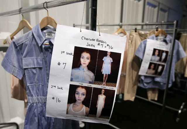 Creations by Charlotte Ronson hang on clothes rails backstage during Berlin Fashion Week Autumn/Winter 2015 in Berlin January 19, 2015. (Photo by Fabrizio Bensch/Reuters)
