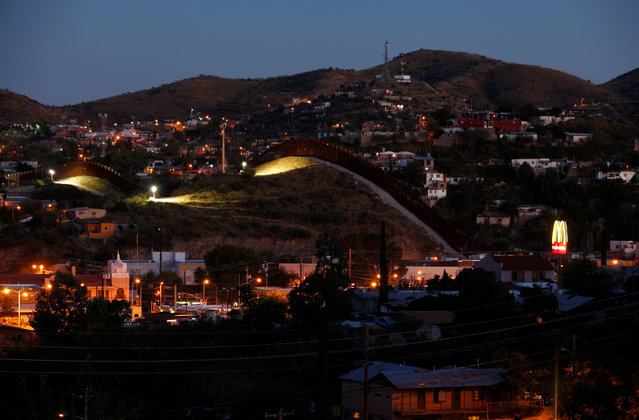 A fence separates the border towns of Nogales, Mexico (R) and Nogales, Arizona, United Sates, October 9, 2016. (Photo by Mike Blake/Reuters)