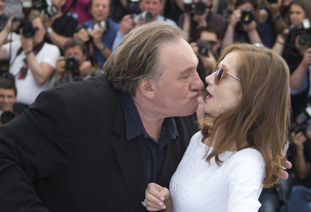 """Gerard Depardieu tries to kiss cast member Isabelle Huppert as they pose during a photocall for the film """"Valley of Love"""" in competition at the 68th Cannes Film Festival in Cannes, May 22, 2015. (Photo by Yves Herman/Reuters)"""