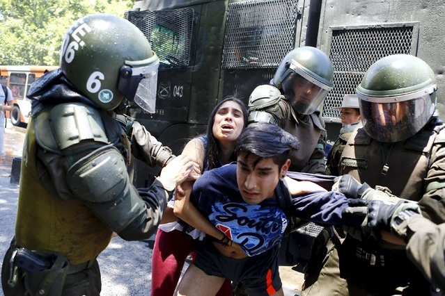 Demonstrators are detained by riot policemen during a protest against the private system of pension fund administrators in Santiago, Chile, December 10, 2015. (Photo by Ivan Alvarado/Reuters)