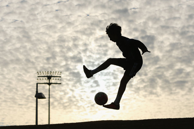A City fan plays with a ball outside the stadium before the round six A-League match between Melbourne City FC and Newcastle Jets at AAMI Park on November 10, 2016 in Melbourne, Australia. (Photo by Michael Dodge/Getty Images)