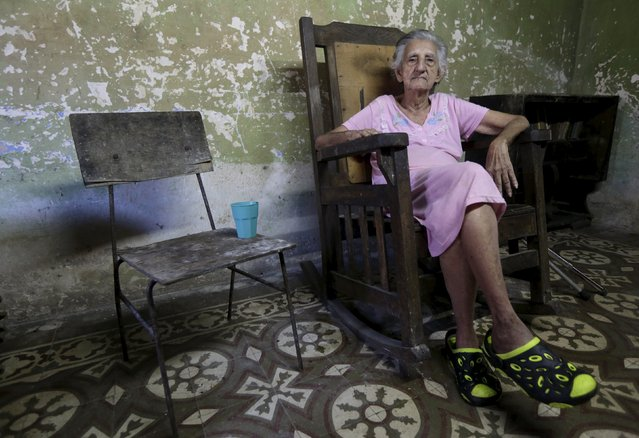 Mariana, 92, sits in her house in Cmaguey province, Cuba November 12, 2015. Picture taken November 12, 2015. (Photo by Enrique de la Osa/Reuters)