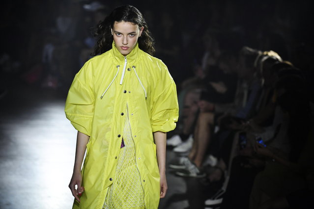 A model presents a creation from the Spring/Summer 2019 men's and women's Collection by designers Humberto Leon and Carol Lim for Kenzo during the Paris Fashion Week, in Paris, France, 24 June 2018. The presentation of the Men's collections runs from 19 to 24 June. (Photo by Julien De Rosa/EPA/EFE)