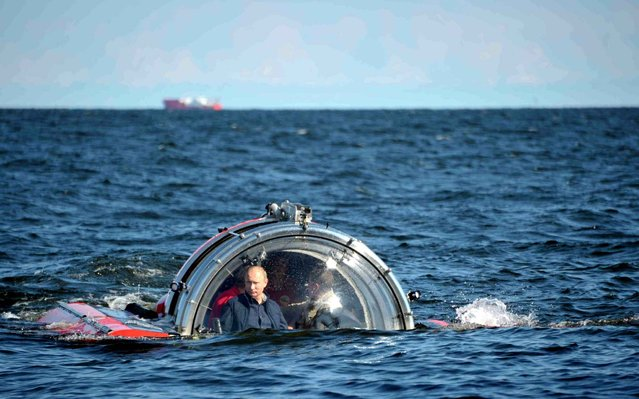"""Russia's President Vladimir Putinr rides in a  C-Explorer 5 submersible after a dive to see the remains of the naval frigate """"Oleg"""", which sank in the 19th century, in the Gulf of Finland in the Baltic Sea, on July 15, 2013. (Photo by Aleksey Nikolskyi/RIA Novosti/Kremlin)"""