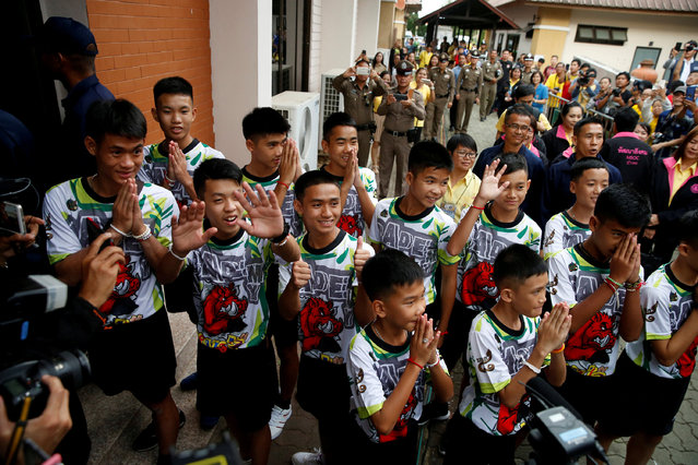 The 12 boys and their soccer coach who were rescued from a flooded cave arrive for a news conference in the northern province of Chiang Rai, Thailand, July 18, 2018. (Photo by Soe Zeya Tun/Reuters)