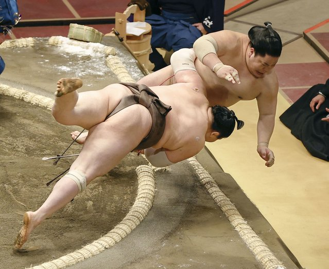 Grand champion Hakuho (front) barely defeats Daieisho on the first day of the Spring Grand Sumo Tournament at Tokyo's Ryogoku Kokugikan on March 14, 2021. (Photo by Kyodo News/Newscom/Profimedia)