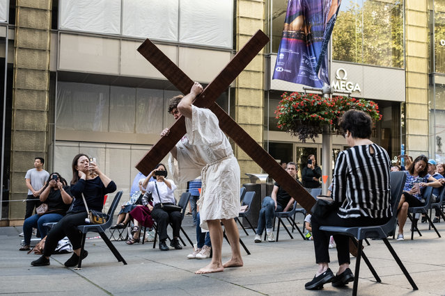 Tim Watkins portraying Jesus carrying a cross during a Good Friday Crucifixion Walk, in Martin Place, Sydney, Friday, April 2, 2021. (Photo by James Gourley/AAP Image)
