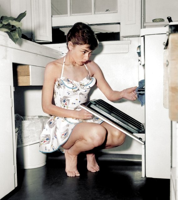 Audrey Hepburn cooking at home, 1954. Colorized by Dana Keller.