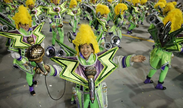 Revellers from the Aguia de Ouro Samba School take part in a carnival at Anhembi Sambadrome in Sao Paulo February 14, 2015. (Photo by Nacho Doce/Reuters)